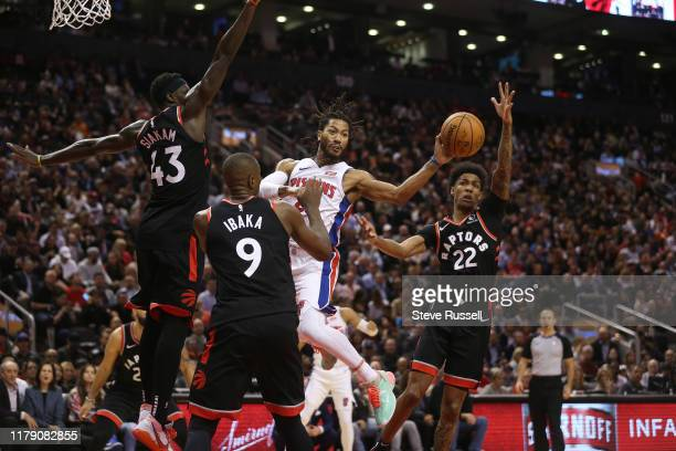 Detroit Pistons guard Derrick Rose passes out of a thrill team as the Toronto Raptors play the Detroit Pistons in NBA action at Scotiabank Arena in...