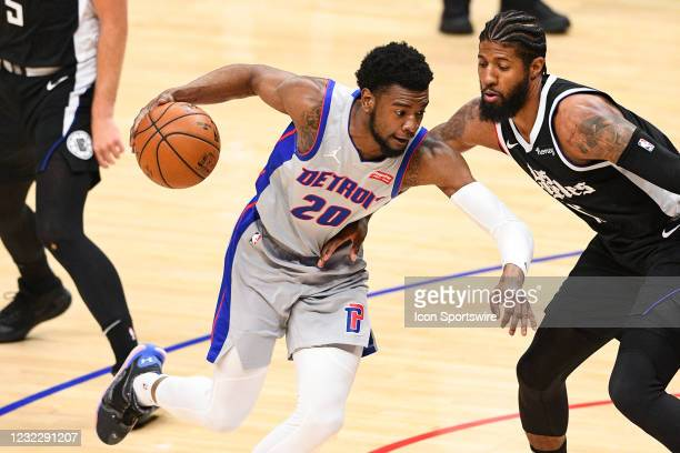Detroit Pistons Guard Josh Jackson guarded closely by Los Angeles Clippers Guard Paul George during a NBA game between the Detroit Pistons and the...