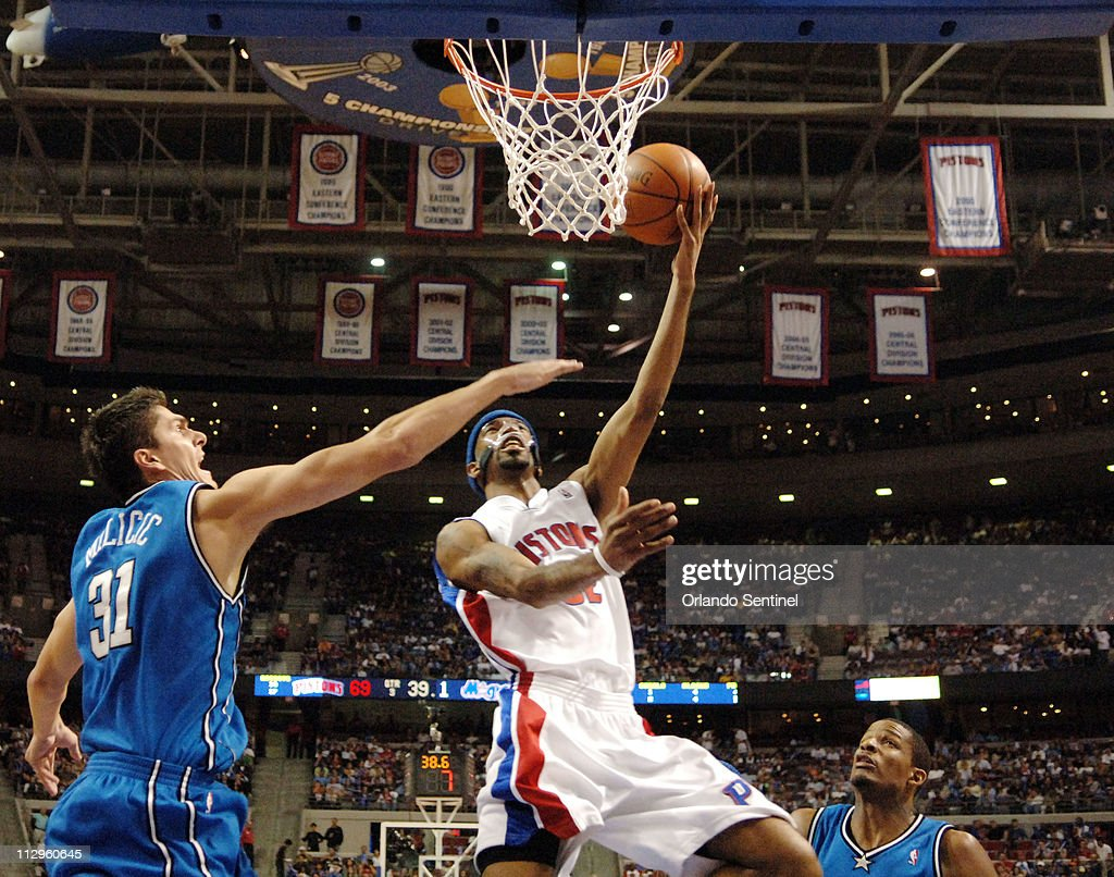 Detroit Pistons guard Richard Hamilton drives to the basket past Orlando Magic defenders Darko Milicic (left) and Trevor Ariza, during the Pistons' 98-90 victory in Game 2 of the first round of the NBA Playoffs at the Palace in Auburn Hills, Michigan, Monday, April 23, 2007.