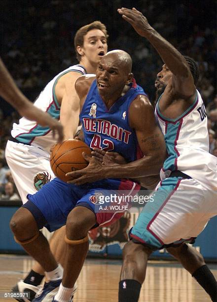 Detroit Piston's Jerry Stackhouse drives to the basket before the Memphis Grizzlies' defence of Pau Gasol of Spain and Michael Dickerson during their...