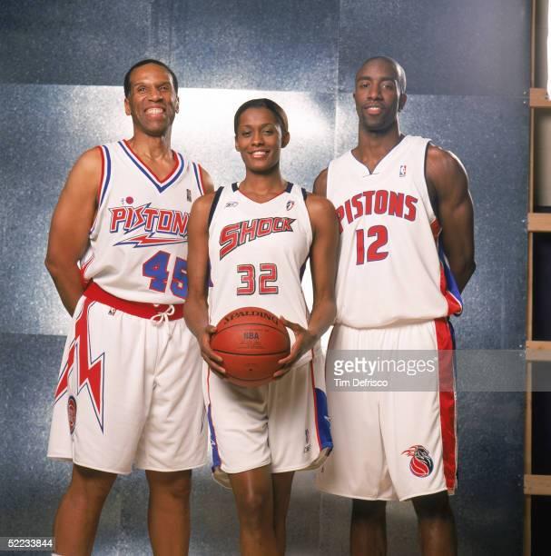 Detroit Pistons legend Adrian Dantley, Swin Cash of the WNBA Detroit Schock and Ronald Dupree of the Detroit Pistons pose for a portrait prior to...