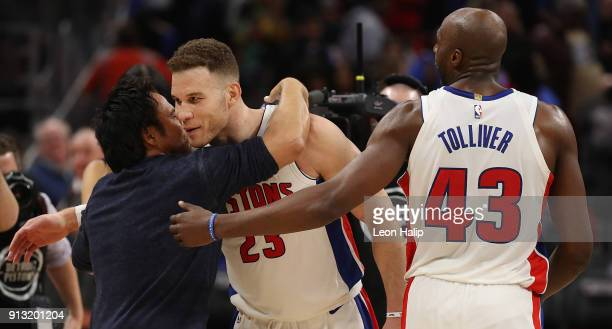 Detroit Pistons owner Tom Gores celebrates with Blake Griffin and Anthony Tolliver of the Detroit Pistons after defeated the Memphis Grizzlies at...