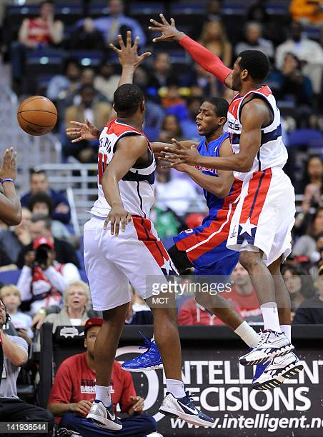 Detroit Pistons point guard Brandon Knight center dishes off the ball around Washington Wizards forward Kevin Seraphin left and Wizards point guard...