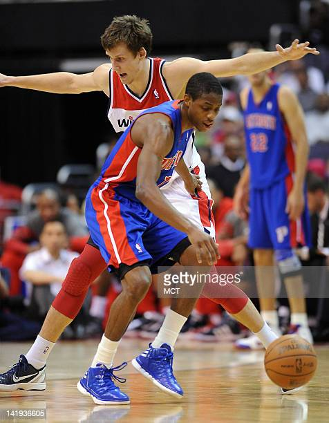 Detroit Pistons point guard Brandon Knight works against Washington Wizards forward Jan Vesely during secondhalf action at the Verizon Center in...