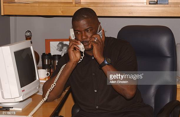 Detroit Pistons president Joe Dumars works the phones in the Pistons' war room during 2003 NBA Draft at the Palace of Auburn Hills June 26 2003 in...