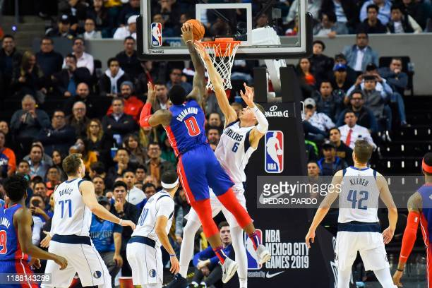 Detroit Pistons' US center Andre Drummond tries to score during their NBA Global Games match against the Dallas Mavericks at the Mexico City Arena,...