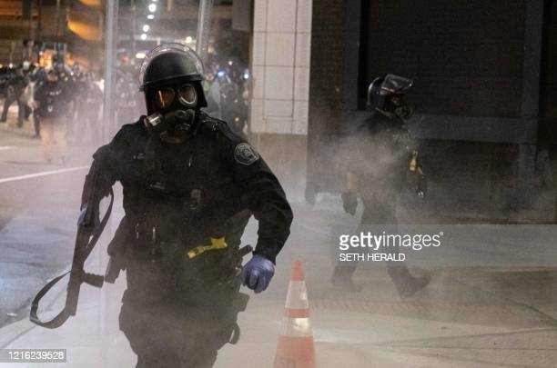 A Detroit Police officer uses teargas during a protest in the city of Detroit Michigan on May 29 over the death of George Floyd a black man who died...