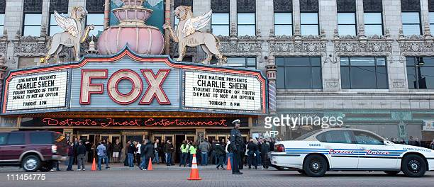 "Detroit Police provide traffic control at the Fox Theatre in Detroit, Michigan on April 2, 2011 to start his show ""Violent Torpedo of Truth/Defeat is..."
