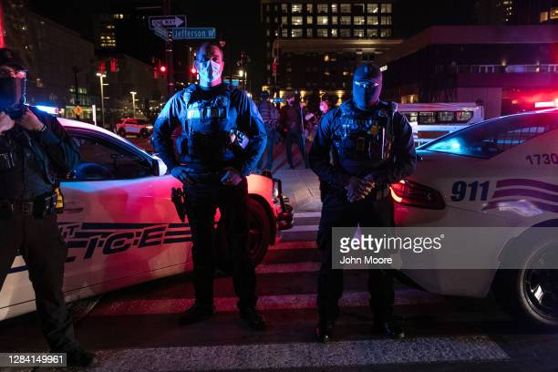 Detroit police stand between Trump supporters and counter protesters outside the TCF election center November 05, 2020 in Detroit, Michigan. Two days...