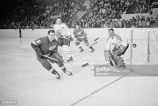 Red Wing Forbes Kennedy eyes a rebound off the stick of Montreal goalie Jacques Plante during 2nd period of DetroitMontreal game Watching the action...