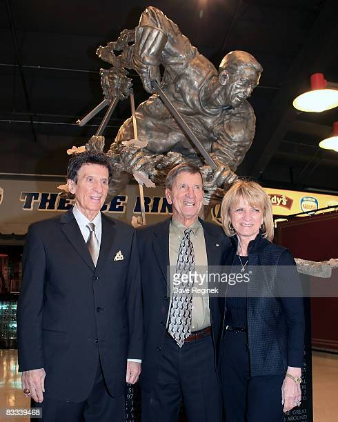 Detroit Red Wing Hall of Famer Ted Lindsay poses for the media with Mike and Marian Ilitch owners of the team after the unvailing of the statue in...