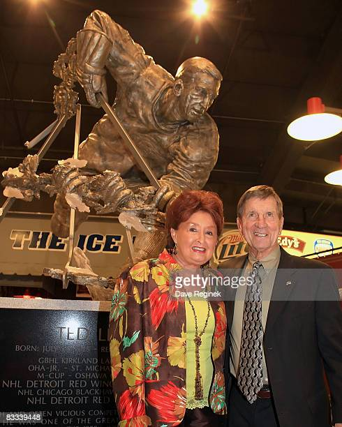 Detroit Red Wing Hall of Famer Ted Lindsay poses with his wife Joanne after the unvailing of the statue in his honor in the concorse at Joe Louis...