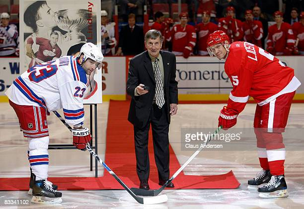 Detroit Red Wing legend Ted Lindsay drops the puck between Chris Drury of the New York Rangers and Nicklas Lidstrom of the Detroit Red Wings in a...