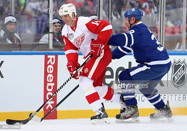 Detroit Red Wings alumni Brendan Shanahan is chased by Toronto Maple Leafs alumni Al Iafrate during the 2017 Rogers NHL Centennial Classic Alumni...