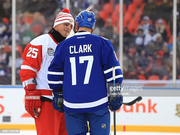 Detroit Red Wings alumni Darren McCarty and Toronto Maple Leafs alumni Wendel Clark talk during the 2017 Rogers NHL Centennial Classic Alumni Game at...