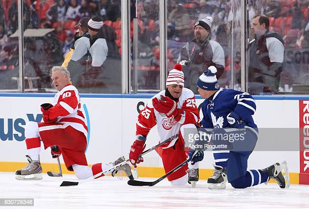 Detroit Red Wings alumni Darren McCarty and Toronto Maple Leafs alumni Tie Domi stretch during warmup during the 2017 Rogers NHL Centennial Classic...