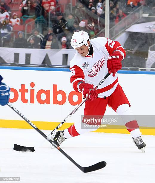 Detroit Red Wings alumni Darren McCarty fires a shot during the 2017 Rogers NHL Centennial Classic Alumni Game at Exhibition Stadium on December 31...