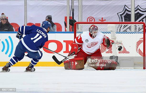 Detroit Red Wings alumni goaltender Manny Legace make a save on Toronto Maple Leafs alumni Gary Leeman during the 2017 Rogers NHL Centennial Classic...