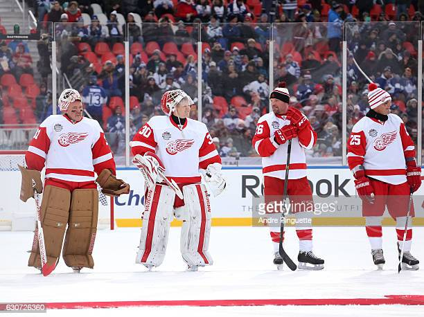Detroit Red Wings alumni Kevin Hodson Chris Osgood Joe Kocur and Darren McCarty line up before taking on Toronto Maple Leafs alumni during the 2017...