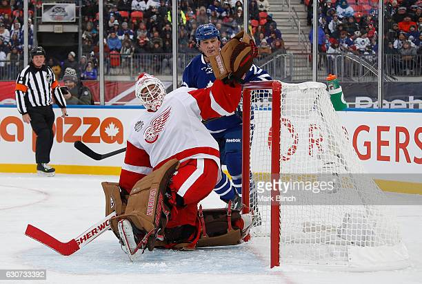 Detroit Red Wings alumni Kevin Hodson makes a save in front of Toronto Maple Leafs alumni Rick Vaive at the 2017 Rogers NHL Centennial Classic Alumni...