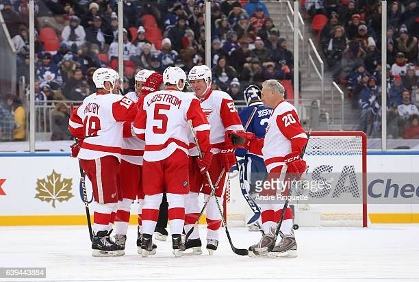 Detroit Red Wings alumni Kirk Maltby Darren McCarty Nicklas Lidstrom Larry Murphy and Mickey Redmond celebrate after a goal on Toronto Maple Leafs...