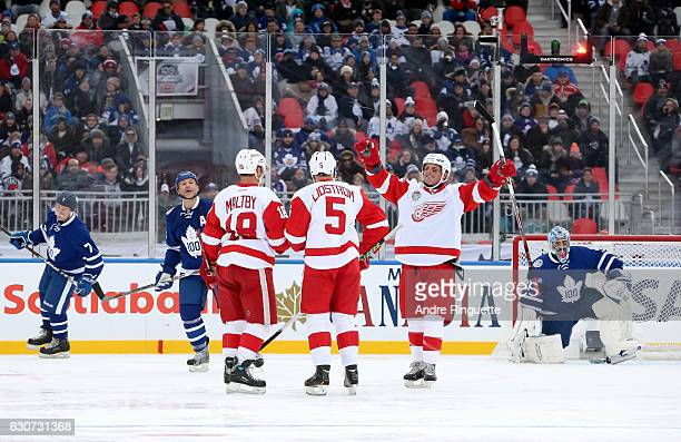 Detroit Red Wings alumni Kirk Maltby Nicklas Lidstrom and Darren McCarty celebrate after a goal on Toronto Maple Leafs alumniduring the 2017 Rogers...