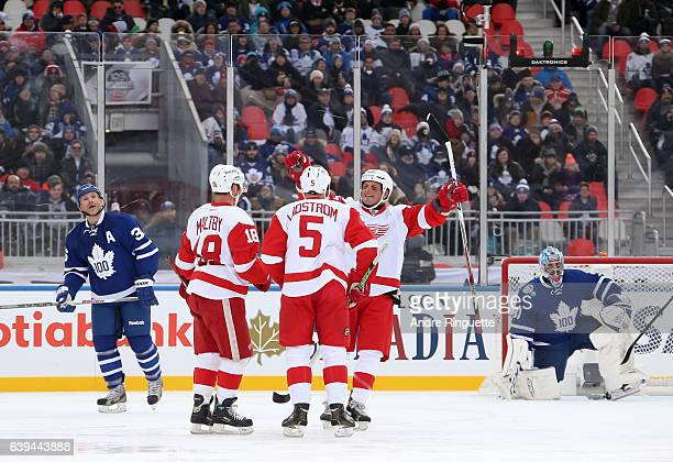 Detroit Red Wings alumni Kirk Maltby Nicklas Lidstrom and Darren McCarty celebrate after a goal on Toronto Maple Leafs alumni Cutis Joseph during the...