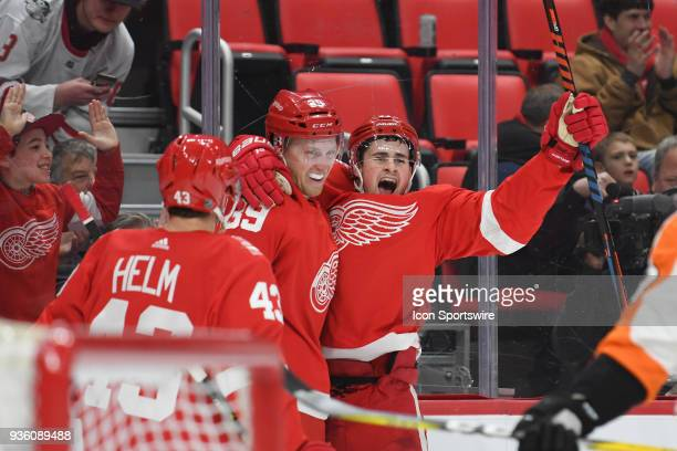 Detroit Red Wings center Dylan Larkin celebrates his goal with Detroit Red Wings right wing Anthony Mantha and Detroit Red Wings left wing Darren...