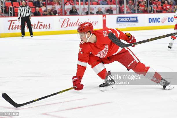 Detroit Red Wings Center Dylan Larkin stretches out to block a centering pass in the NHL hockey game between Carolina Hurricanes and Detroit Red...