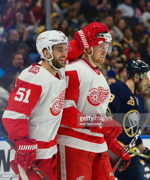 Detroit Red Wings center Frans Nielsen and Detroit Red Wings right wing Anthony Mantha celebrate a goal during an NHL game between the Detroit Red...
