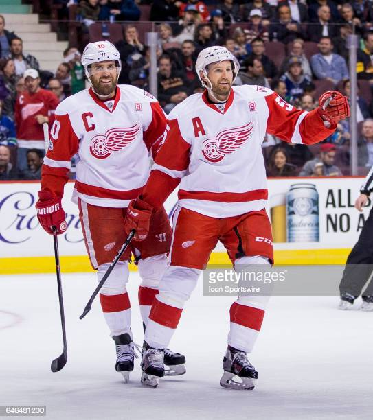 Detroit Red Wings Center Henrik Zetterberg and Niklas Kronwall celebrate Center Frans Nielsen's second goal of the first period against the Vancouver...