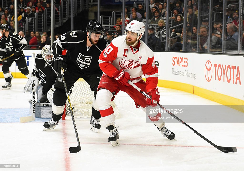 Detroit Red Wings Center Henrik Zetterberg (40) maneuvers the puck around Los Angeles Kings Defenceman Derek Forbort (24) during an NHL game between the Detroit Red Wings and the Los Angeles Kings on January 05, 2017, at STAPLES Center in Los Angeles, CA. The Red Wings defeated the Kings 4-0.
