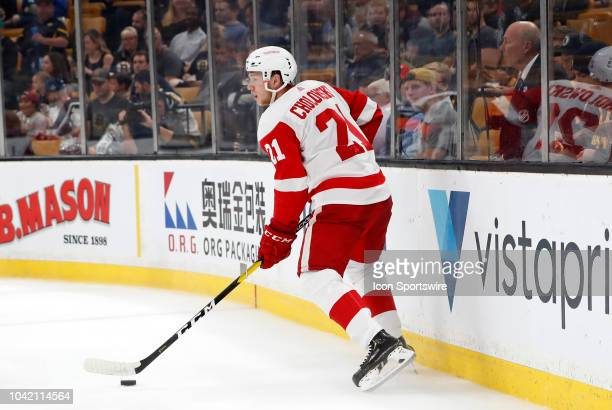 Detroit Red Wings defenseman Dennis Cholowski looks to start a rush during a preseason game between the Boston Bruins and the Detroit Red Wings on...