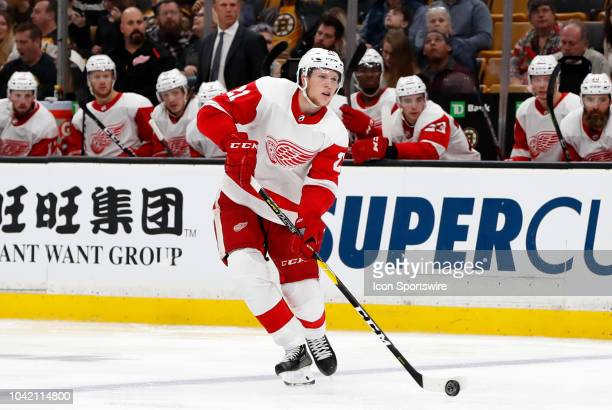 Detroit Red Wings defenseman Dennis Cholowski moves the puck on the power play during a preseason game between the Boston Bruins and the Detroit Red...