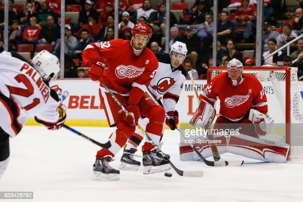 Detroit Red Wings defenseman Jonathan Ericsson of Sweden and New Jersey Devils forward Miles Wood react to snapshot on goal by New Jersey Devils...