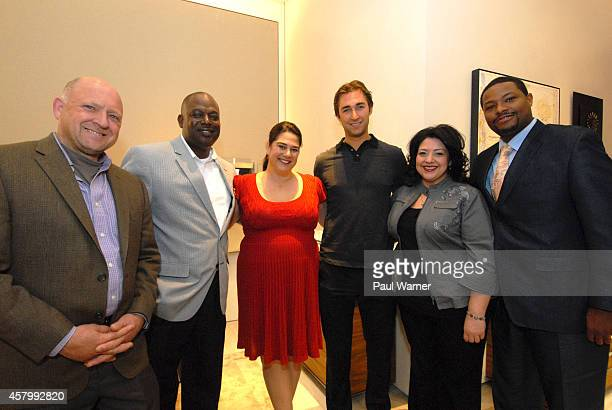 Detroit Red Wings defensemen Kyle Quincey poses with Greening of Detroit members Dean Hay Lionel Bradford Rebecca Salminen Witt Monica Tabares and...
