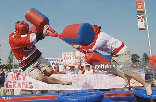 Detroit Red Wings fan and a Carolina Hurricanes fan meet in the parking lot outside the Entertainment Sports Arena for a round of jousting before...