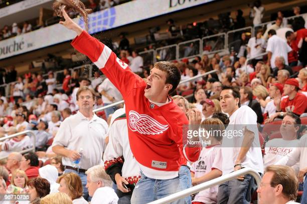 Detroit Red Wings fan throws an octopus on the ice during third period play against the Phoenix Coyotes in Game Seven of the Western Conference...