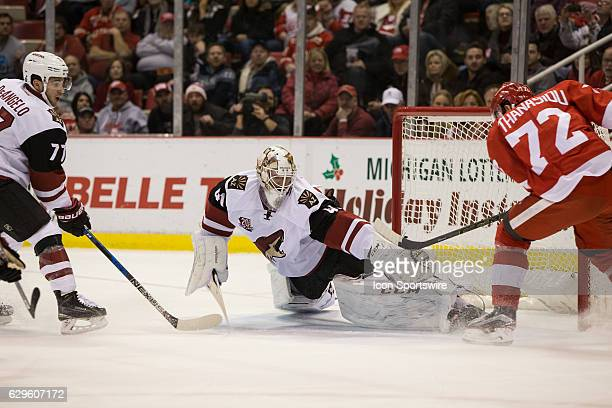 Detroit Red Wings forward Andreas Athanasiou scores a goal against Arizona Coyotes goalie Mike Smith during the first period of a regular season NHL...