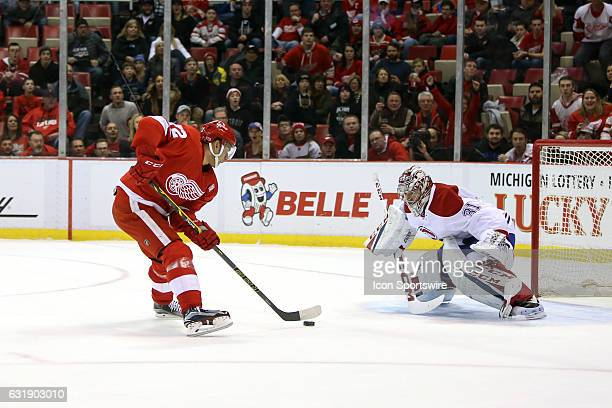 Detroit Red Wings forward Andreas Athanasiou skates with the puck during a breakaway while Montreal Canadiens goalie Carey Price protects the net...