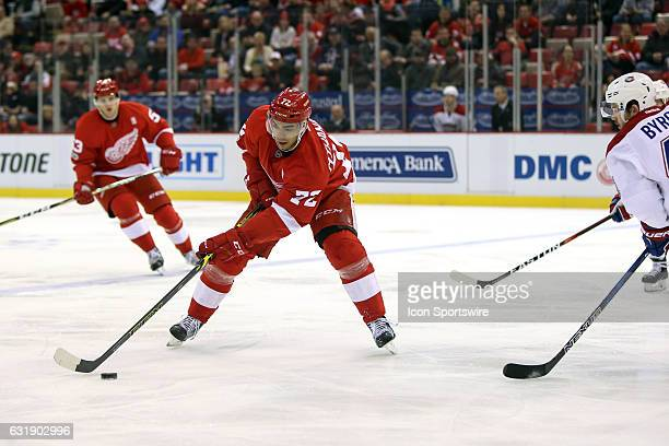 Detroit Red Wings forward Andreas Athanasiou skates with the puck during the first period of a regular season NHL hockey game between the Montreal...