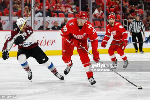 Detroit Red Wings forward Anthony Mantha skates with the puck against Colorado Avalanche forward Nail Yakupov of Russia during the second period of a...
