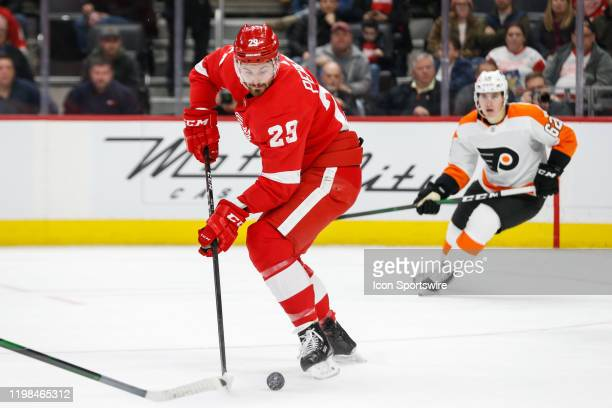Detroit Red Wings forward Brendan Perlini of England skates with the puck during the second period of a regular season NHL hockey game between the...