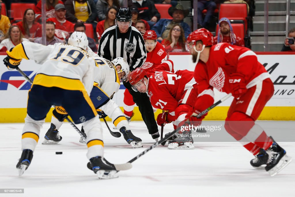 Detroit Red Wings forward Dylan Larkin (71) and Nashville Predators forward Kyle Turris (8) face off during the third period of a regular season NHL hockey game between the Nashville Predators and the Detroit Red Wings on February 20, 2018, at Little Caesars Arena in Detroit, Michigan. Nashville defeated Detroit 3-2.