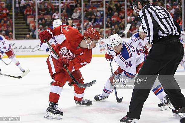 Detroit Red Wings forward Dylan Larkin and New York Rangers forward Oscar Lindberg of Sweden wait for the puck to be dropped during a faceoff during...
