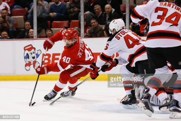 Detroit Red Wings forward Henrik Zetterberg of Sweden skates with the puck during the third period of a regular season NHL hockey game between the...