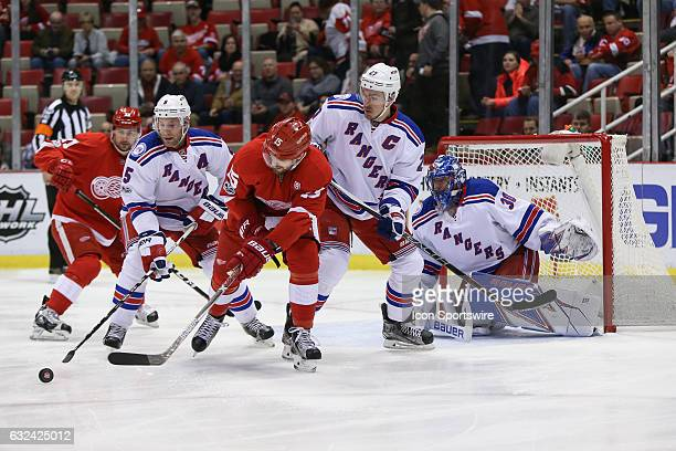 Detroit Red Wings forward Riley Sheahan and New York Rangers defenseman Dan Girardi battle for control of the puck during the first period of a...