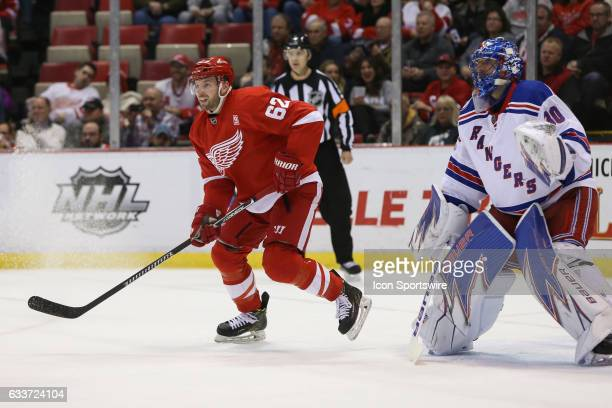 Detroit Red Wings forward Thomas Vanek of Austria and New York Rangers goalie Henrik Lundqvist of Sweden watch the play during a regular season NHL...