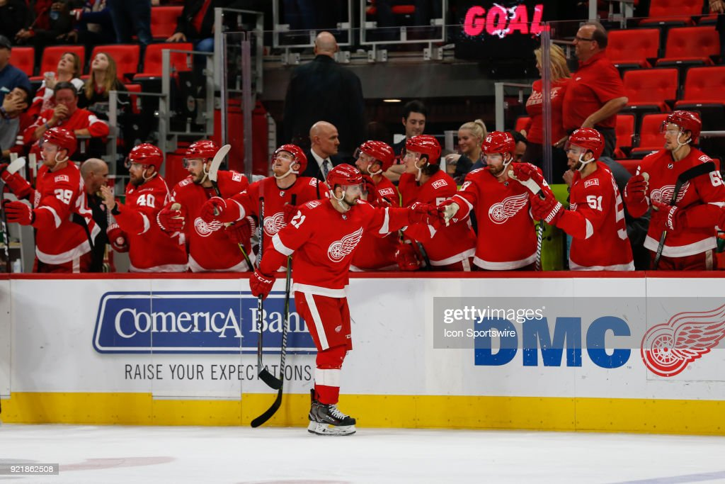 Detroit Red Wings forward Tomas Tatar, of Slovakia, (21) receives congratulations from his teammates on the bench after scoring a goal during the third period of a regular season NHL hockey game between the Nashville Predators and the Detroit Red Wings on February 20, 2018, at Little Caesars Arena in Detroit, Michigan. Nashville defeated Detroit 3-2.