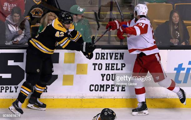 Detroit Red Wings' Frans Nielsen right is injured by a hit from the Bruins' David Backes during the first period The Boston Bruins host the Detroit...